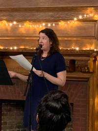 Carrie Conners reads climate-inspired work at the Dear Ocean event in Brooklyn, New York on August 23, 2019.